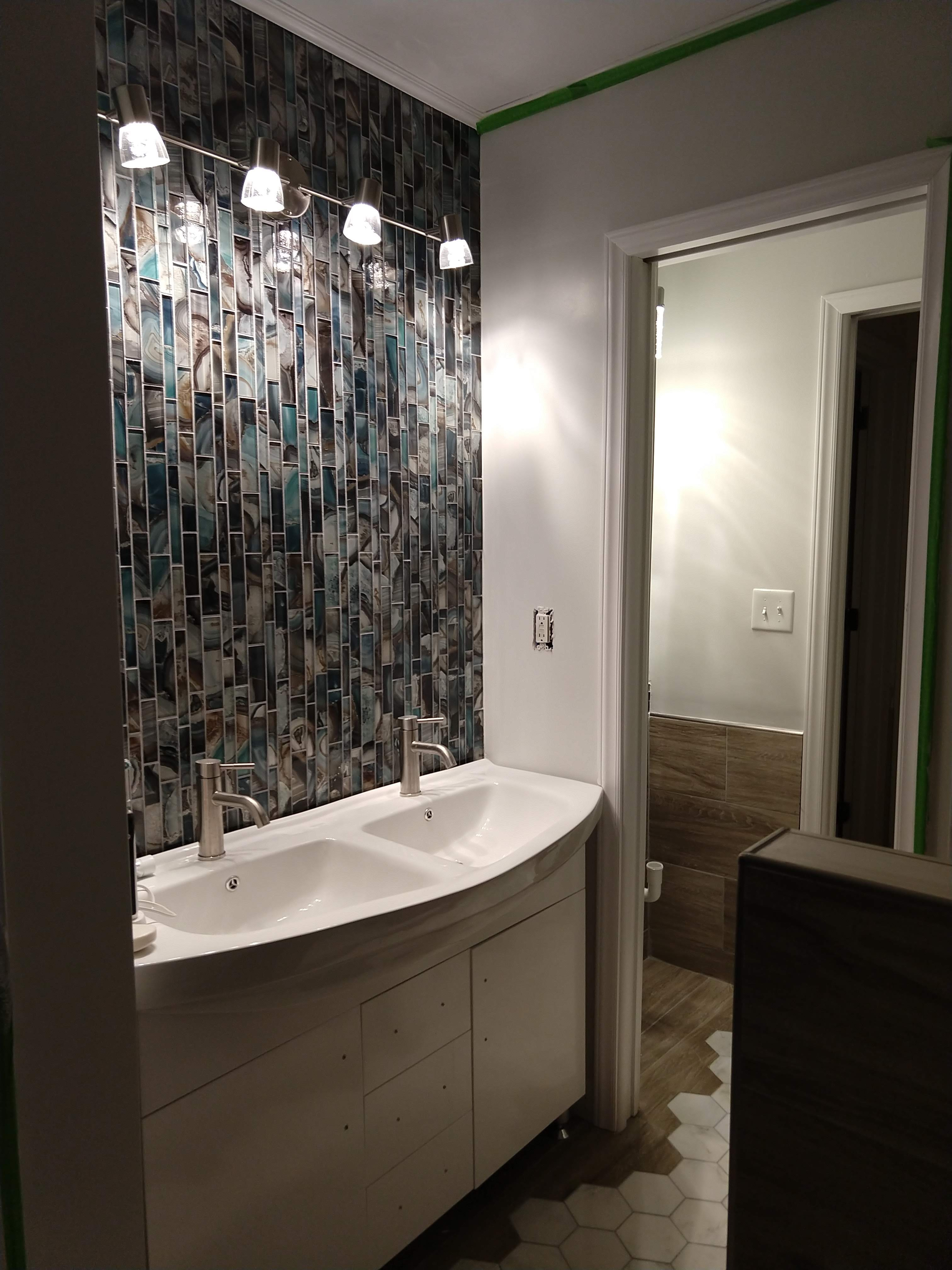 Look at possible different designs with glass mosaic tiles